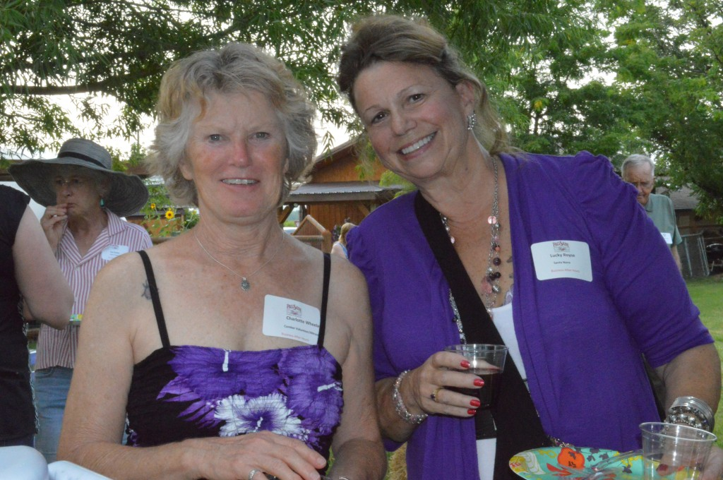 Lovely in Lavender? Outstanding in Orchid? Pretty in Purple works too, to describe Charlotte Wheeler, left, and Lucky Royse, two of the Chambers energetic volunteers.