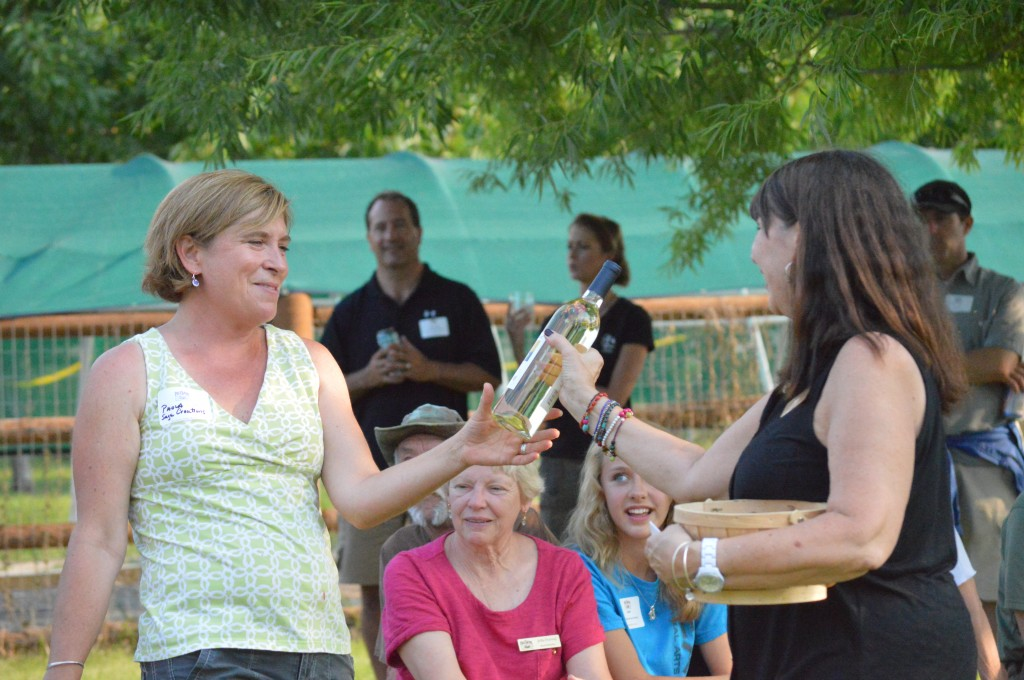 Paola Legarre, owner of Sage Creations Organic Farm, and the event host, won a bottle of wine for her efforts.