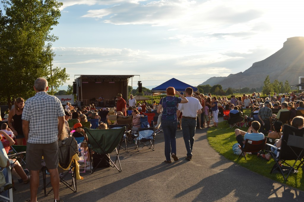 Fans brought lawn chairs but no umbrellas were needed as the sun set behind Mt. Garfield.