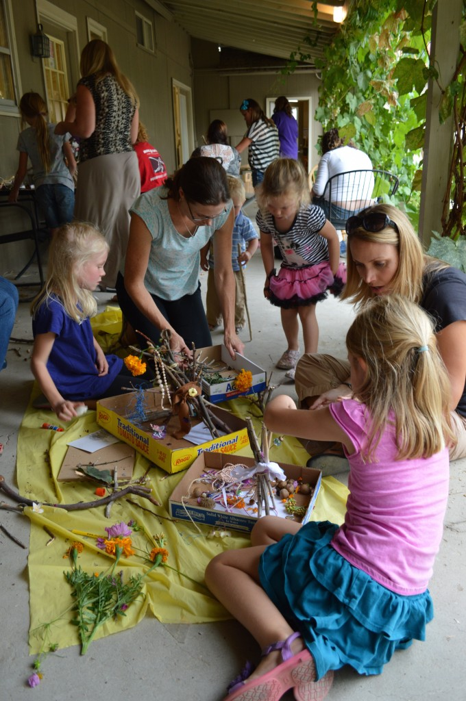 The back patio was alive with busy kids, weaving sticks, grasses and other natural materials into one-of-a-kind accommodations for the area's fairy population.