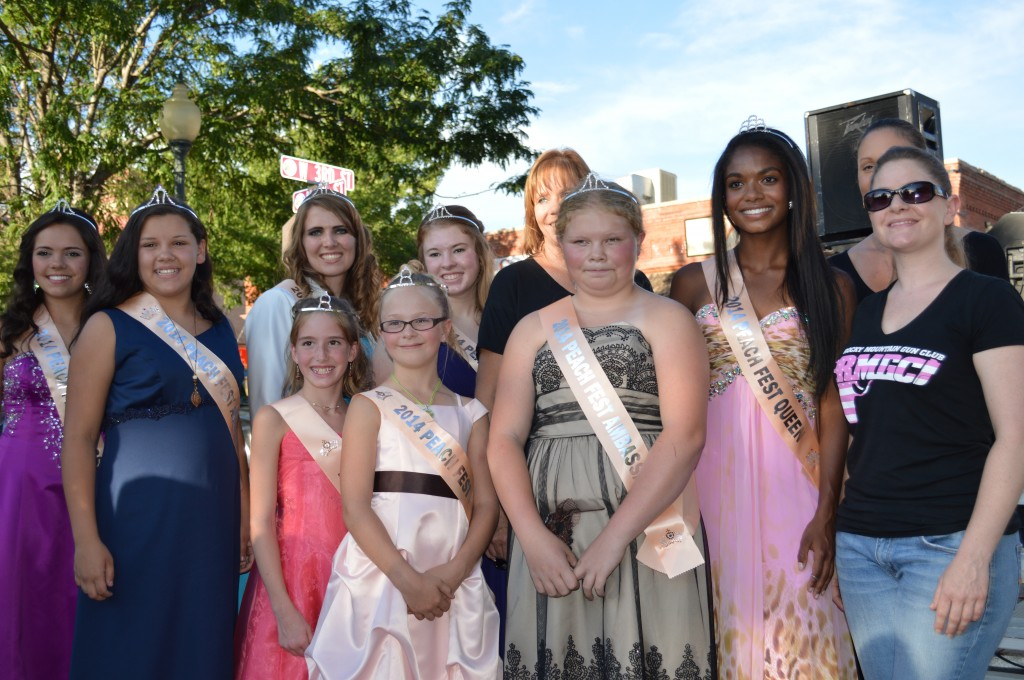 Bailey McCall, second from right, was crowned as the 2014 Peach Queen, here with her Court and sponsors from the Rocky Mountain Gun Club.