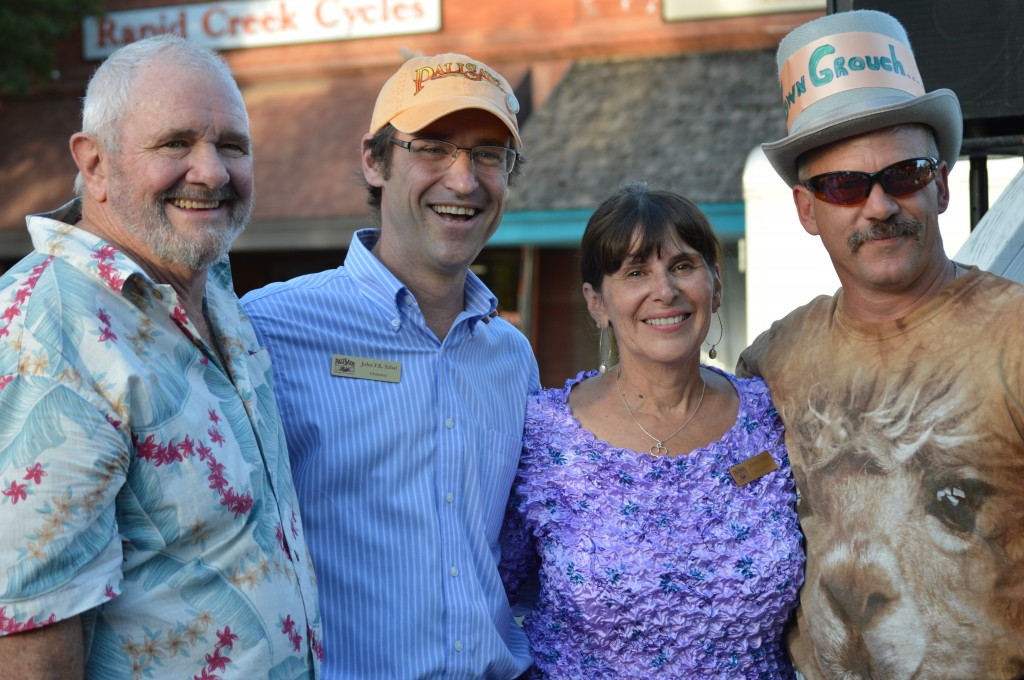 Outgoing Grouch Jim Cox, Chamber Chairman John Sabal, Chamber Director Juliannn Adams and New Town Grouch Mike McDermott at Thursday evening's Ice Cream Social in downtown Palisade.