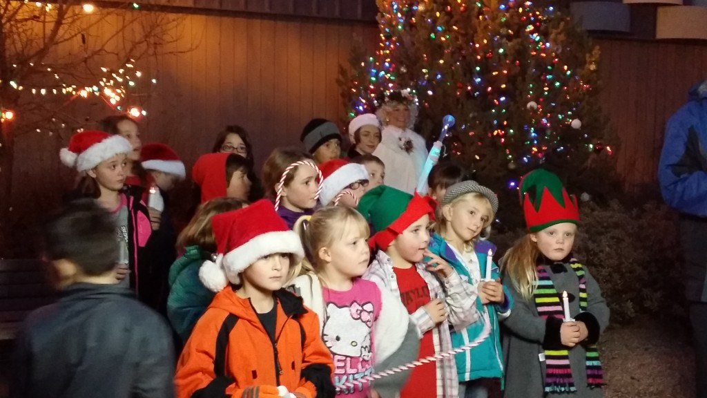 Kids from Taylor Elementary School sang Christmas carols and helped Santa Nana   light the Town's Christmas Tree in the Plaza.