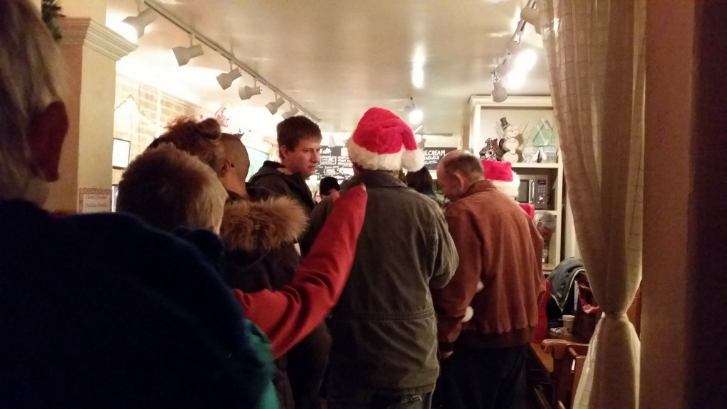 Parade watchers were lined up out the door of the Slice O'Life Bakery, where Altrusa was selling a variety of hot soups to warm everyone's spirits.