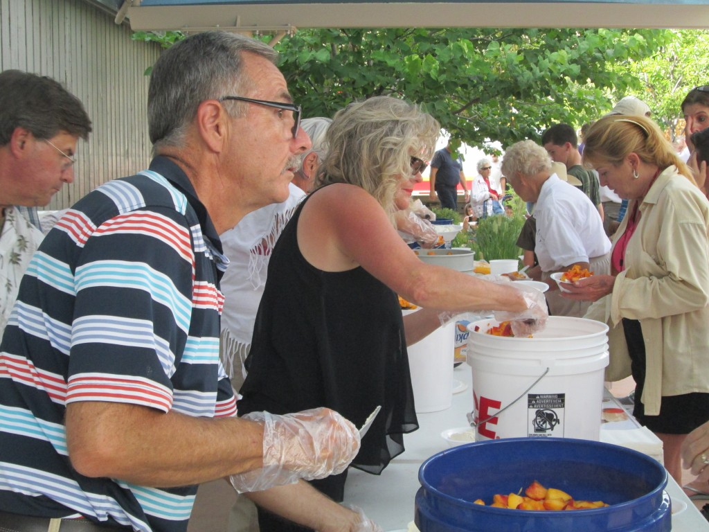 SERVICE FREE PEACHES AND ICE CREAM, FRANK WATT, PALISADE PUBLIC WORKS DIRECTOR; ROBYNN SUNDERMEIER, TOWN TRUSTEE, PEACH FESTIVAL, 8-19-16