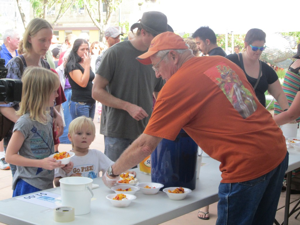 SERVING FREE PEACHES AND ICE CREAM, MAYOR ROGER GRANAT, PALISADE PEACH FESTIVAL, 8-19-16